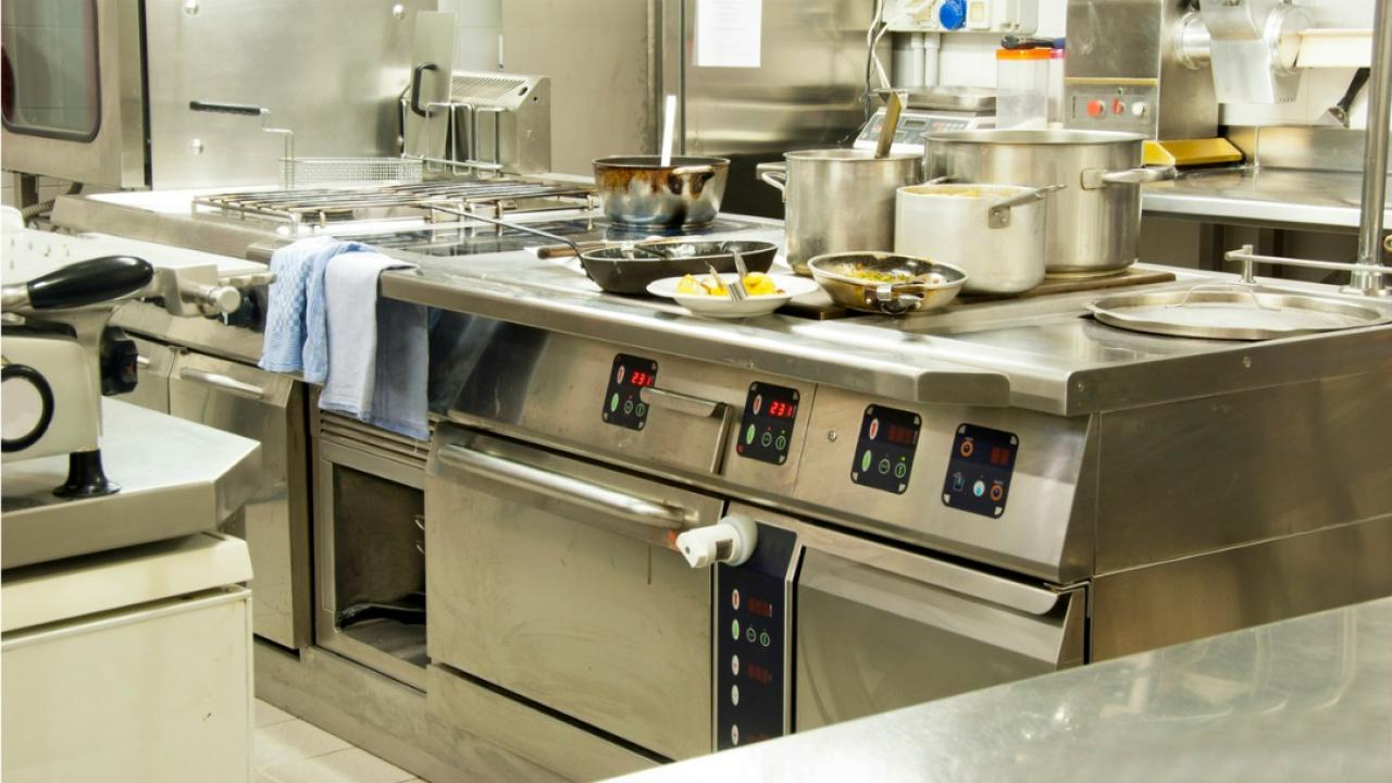 a restaurant kitchen with prepped food but no workers