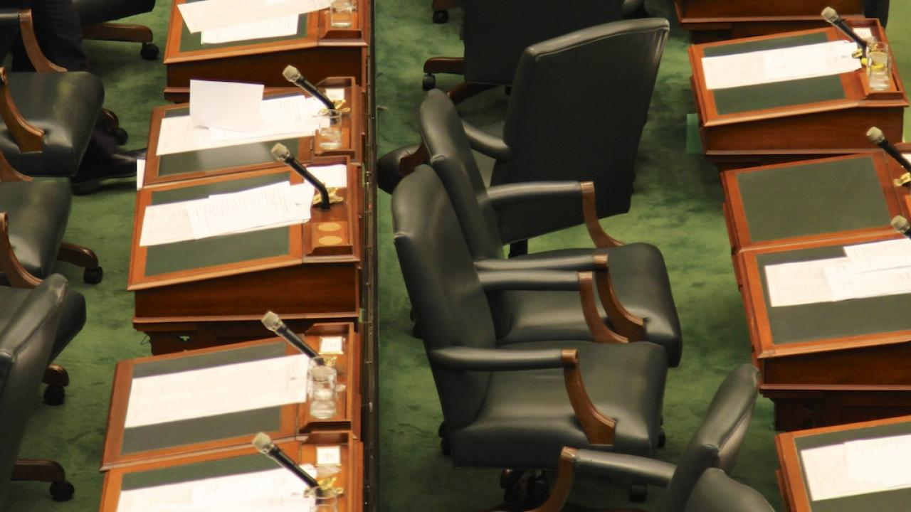 empty seats in the legislature at Queen's Park