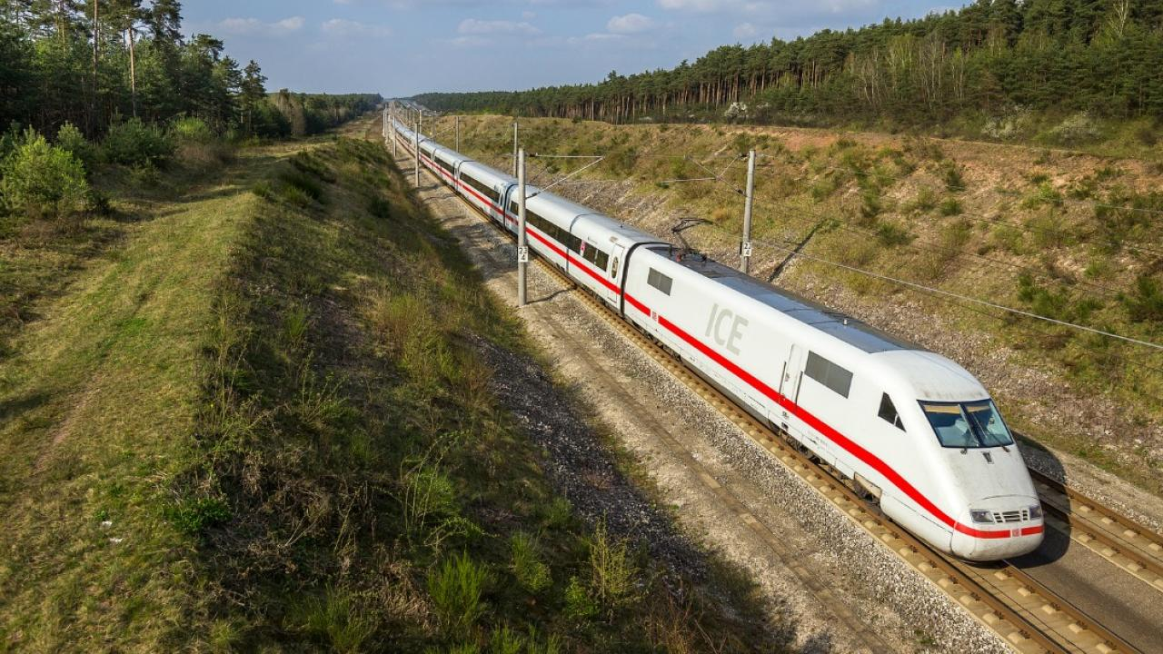 a high speed train driving through the country