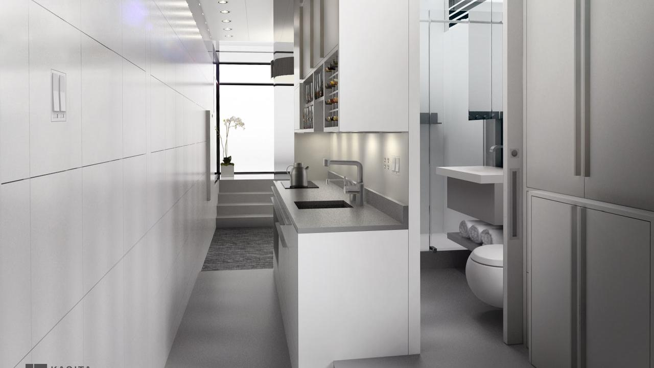 Space-efficient kitchen by Kasita. Counter and sink in the middle of the space. Grey counter tops and white cabinets.