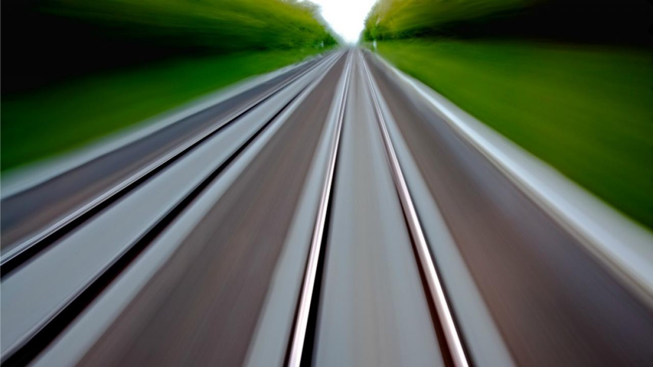 blurring of rail lines as a train passes