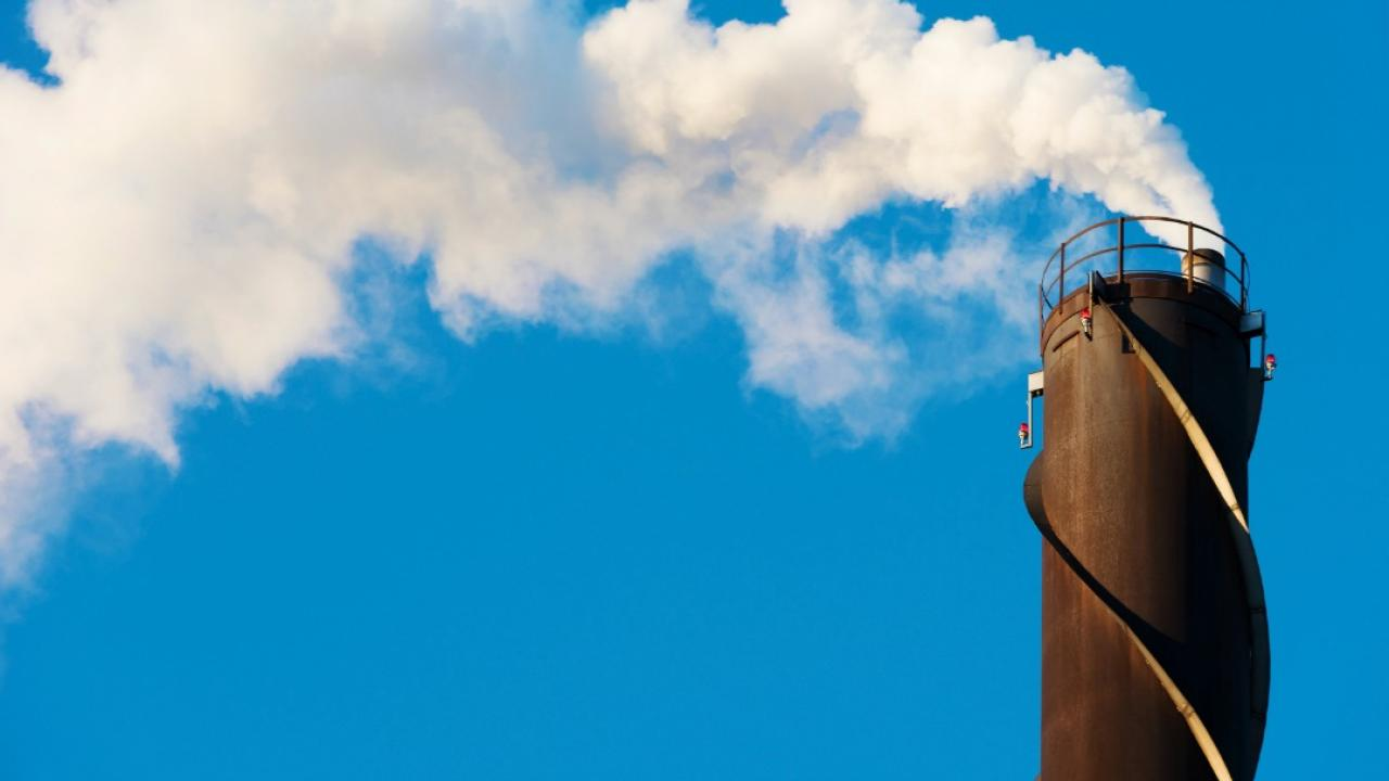 industrial smoke stack sending pollution into the air