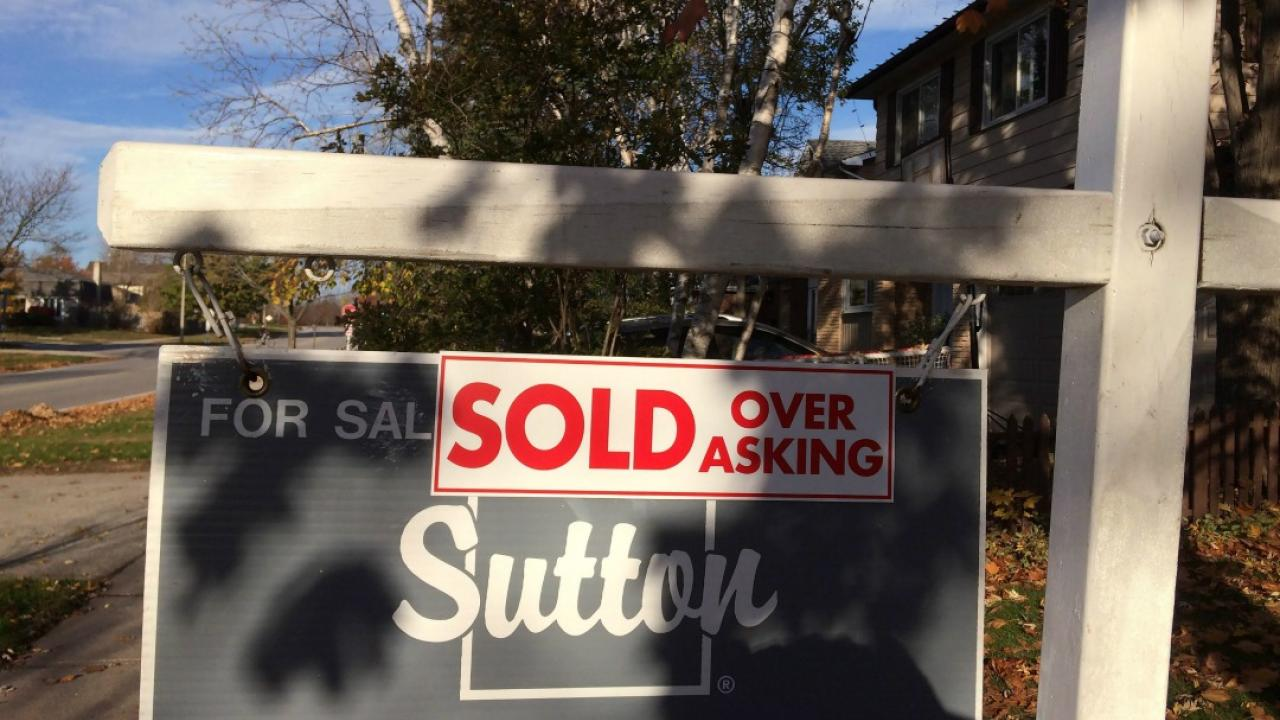 """a real estate sign that reads, """"sold over asking"""""""