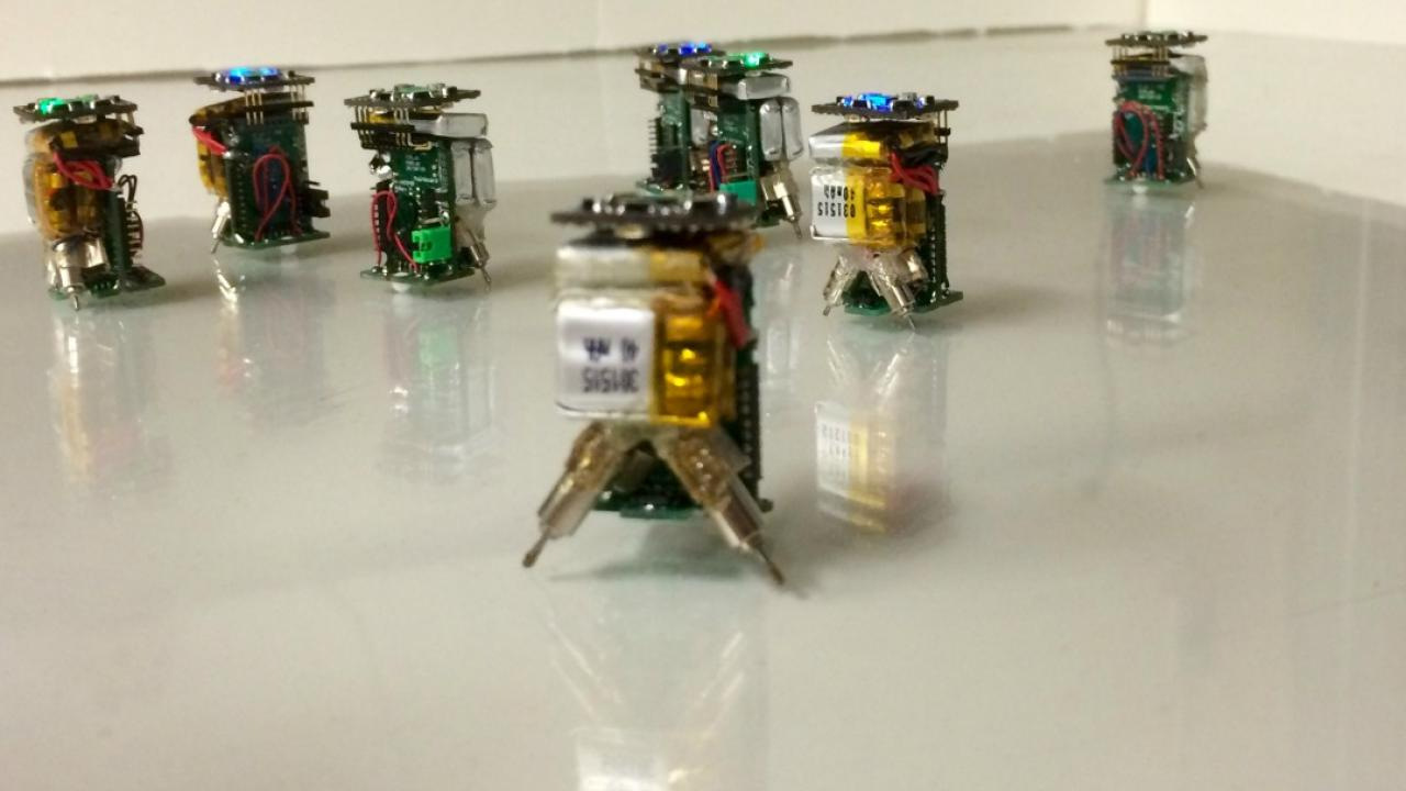tiny robots placed together on a table