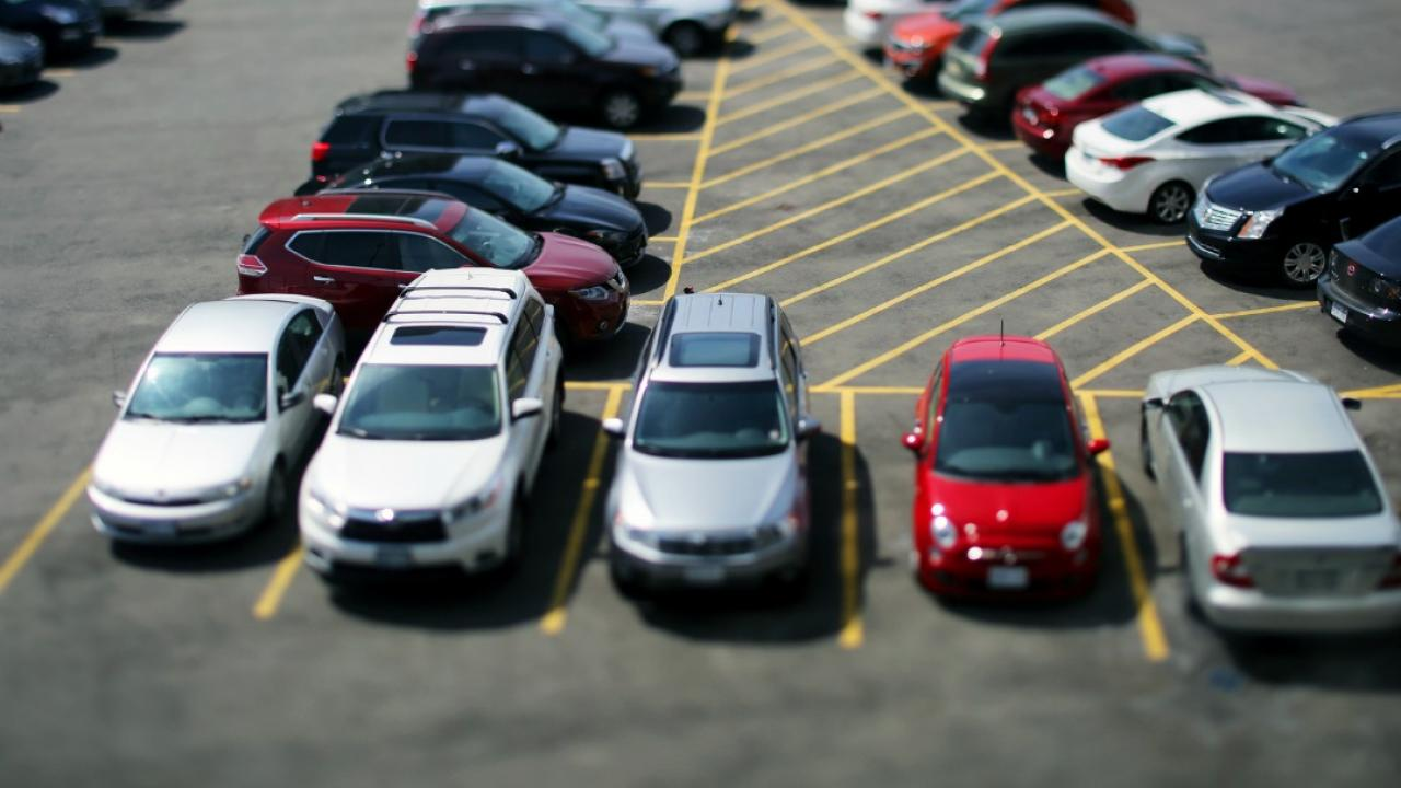 cars lined up in an urban parking lot