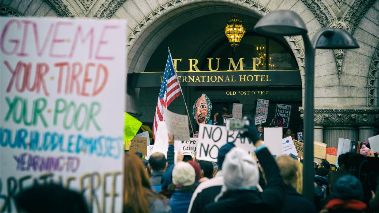 people protesting in front of Trump Tower in Washington, D.C.