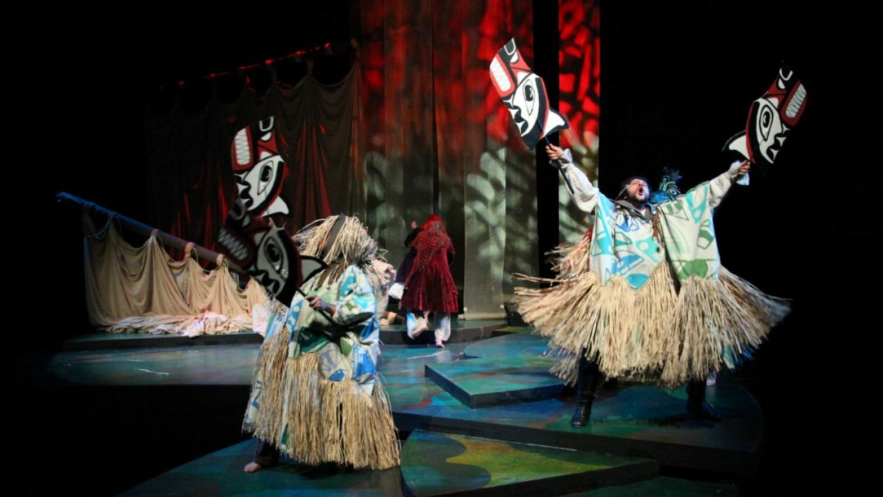 actors as wolves on stage in a Haida Gwaii interpretation of The Tempest