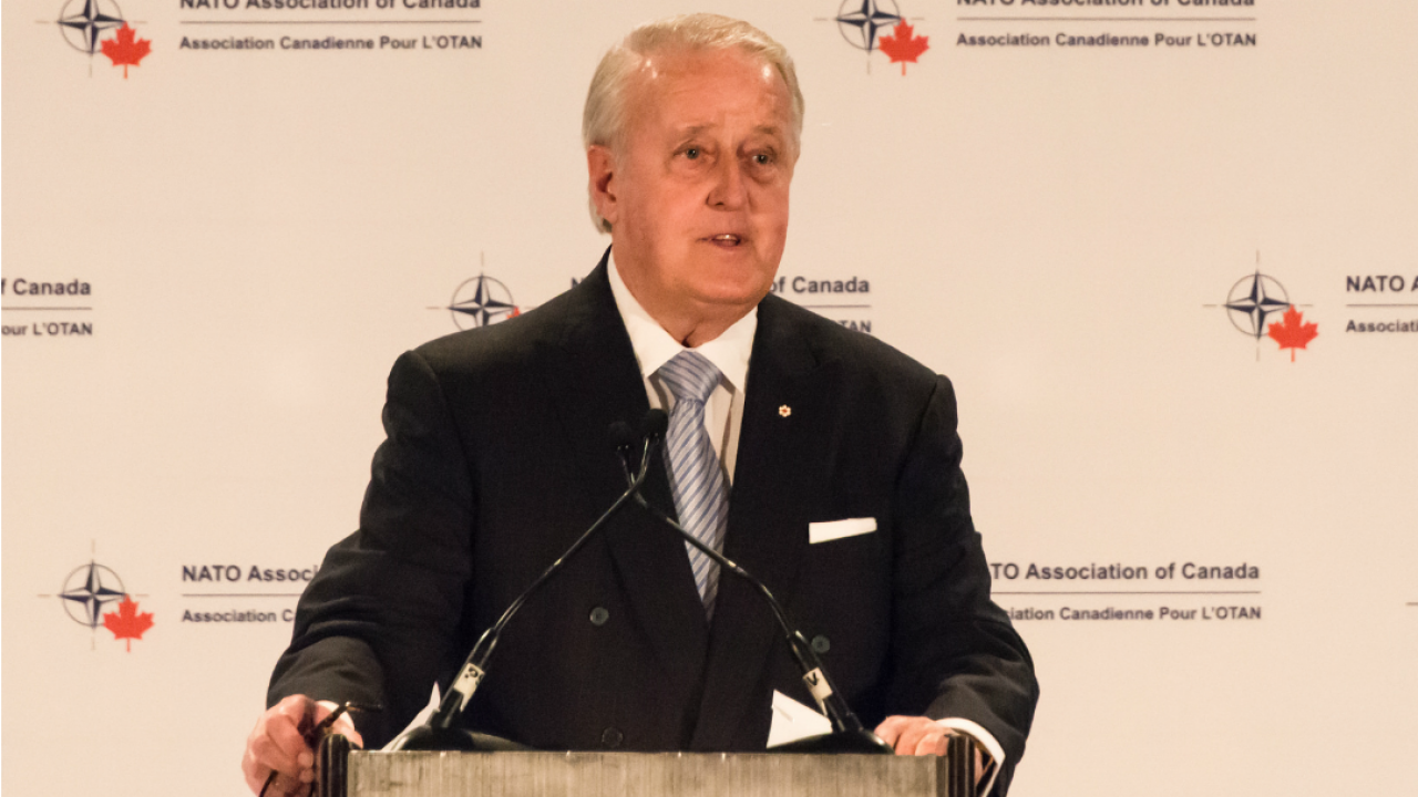 Former prime minister Brian Mulroney at a podium