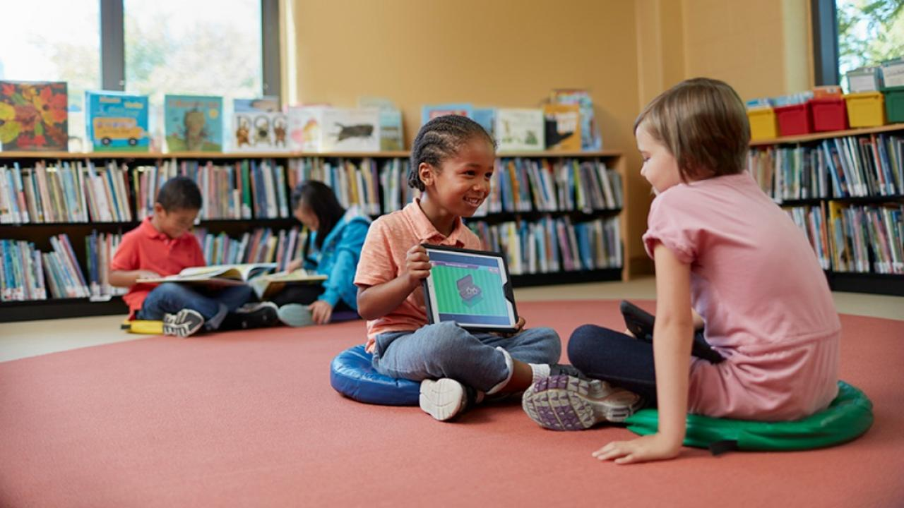 Kids engage with TVO's mPower on a tablet.