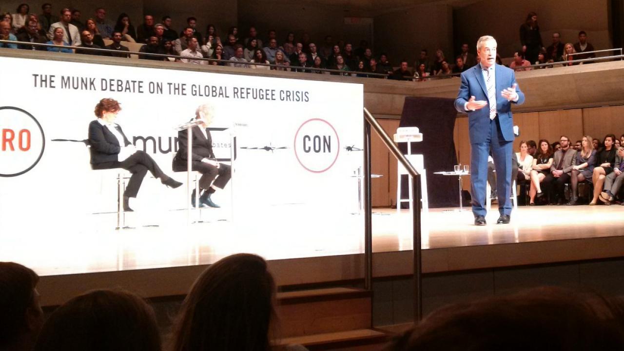 United Kingdom Independence Party Leader Nigel Farage speaks on stage.