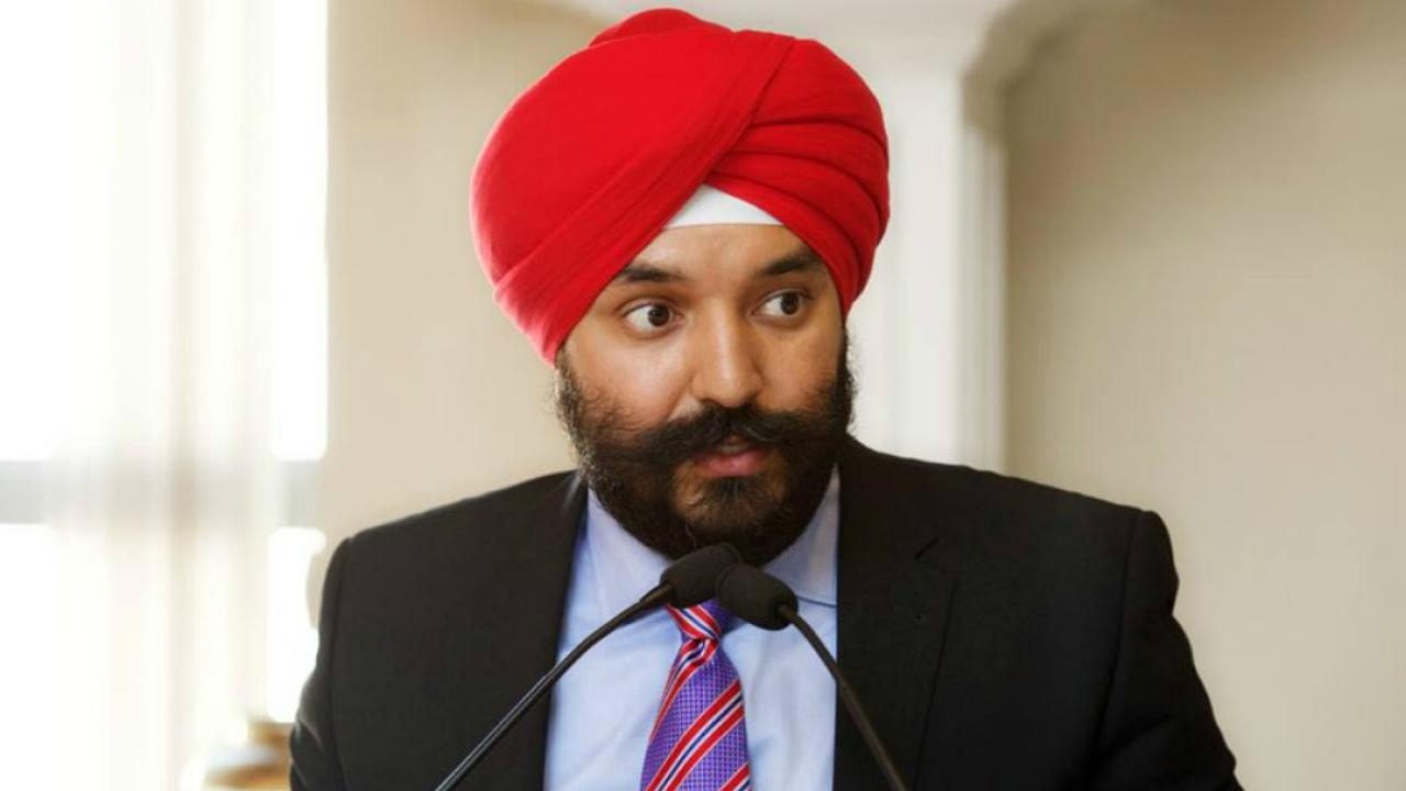 Federal Liberal cabinet minister Navdeep Bains speaks at a microphone.