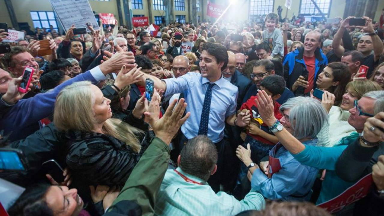 Justin Trudeau shakes hands in a crowd