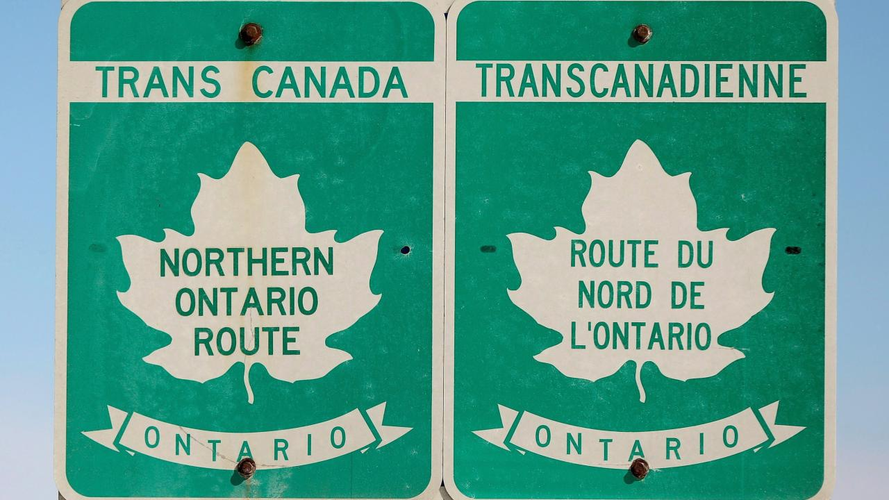 A sign indicates the northern route of the TransCanada Highway outside Kapsuskasing,