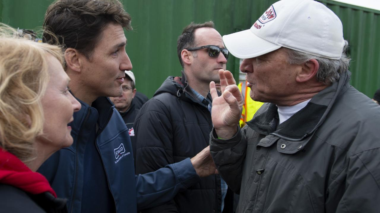 Justin Trudeau listens to angry man.