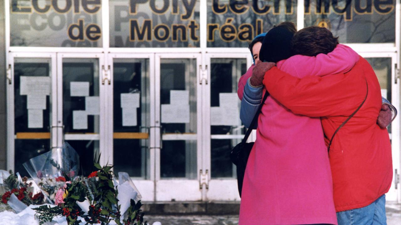 people hugging in front of Montreal's Ecole Polytechnic