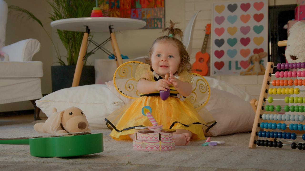 Music time with baby in a playroom