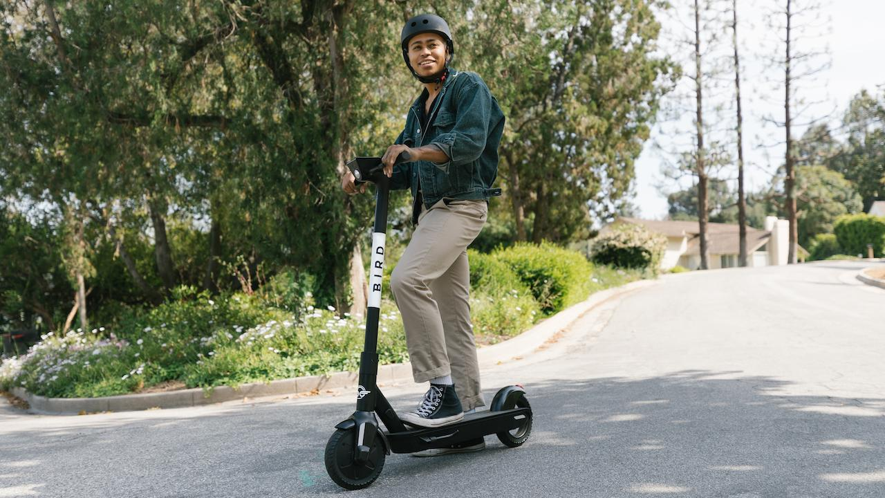 young man with helmet on a scooter