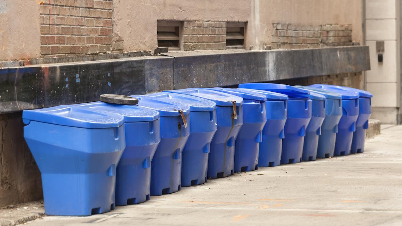 a row of blue bins