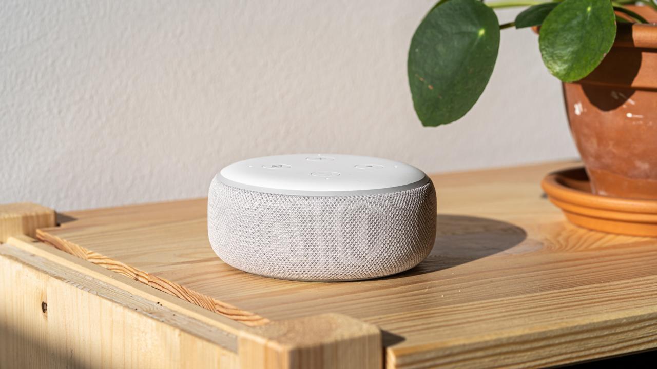 Digital assistant speaker on a desk.