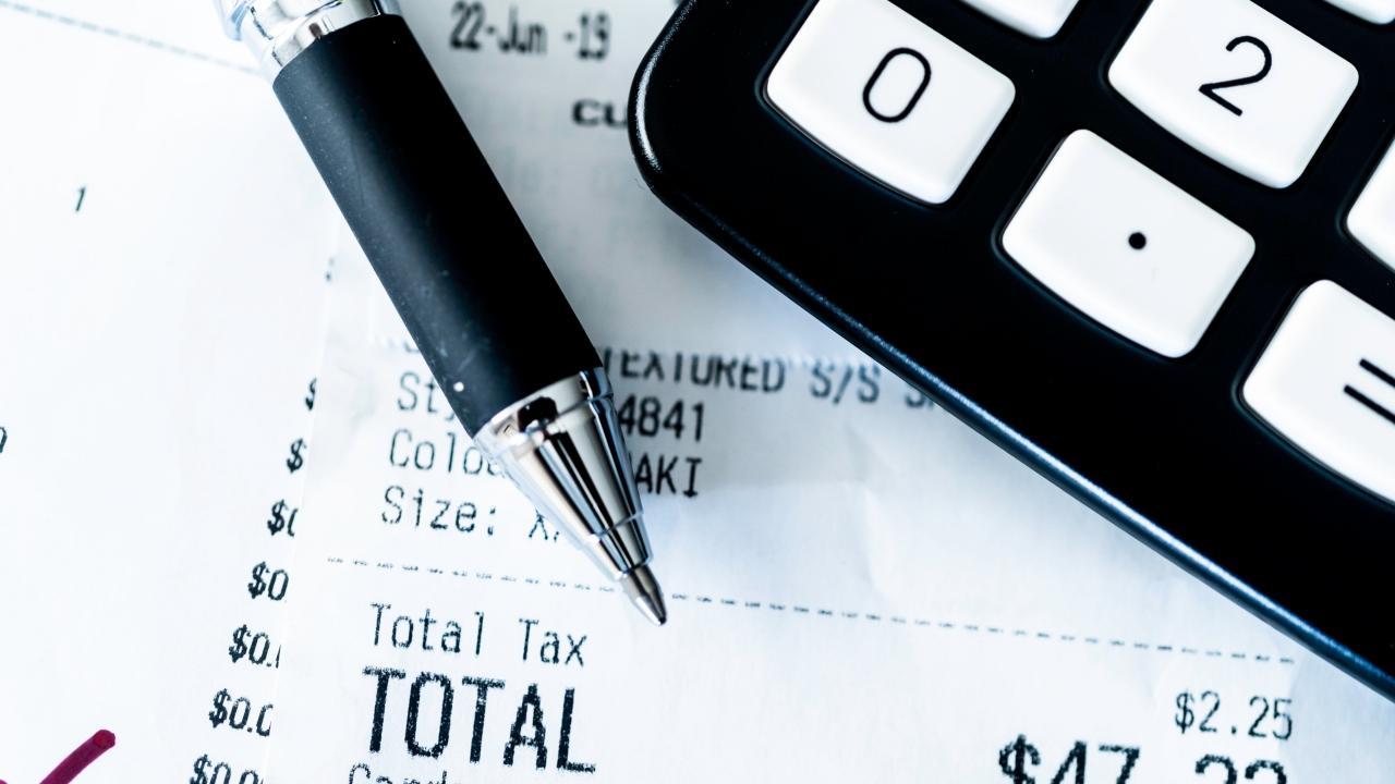 calculator, pen and receipt