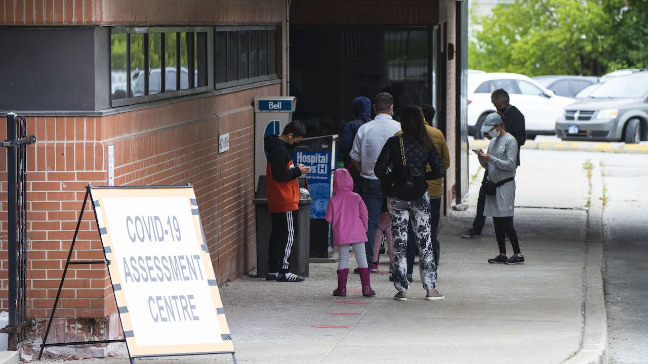 people line up outside a COVID testing centre