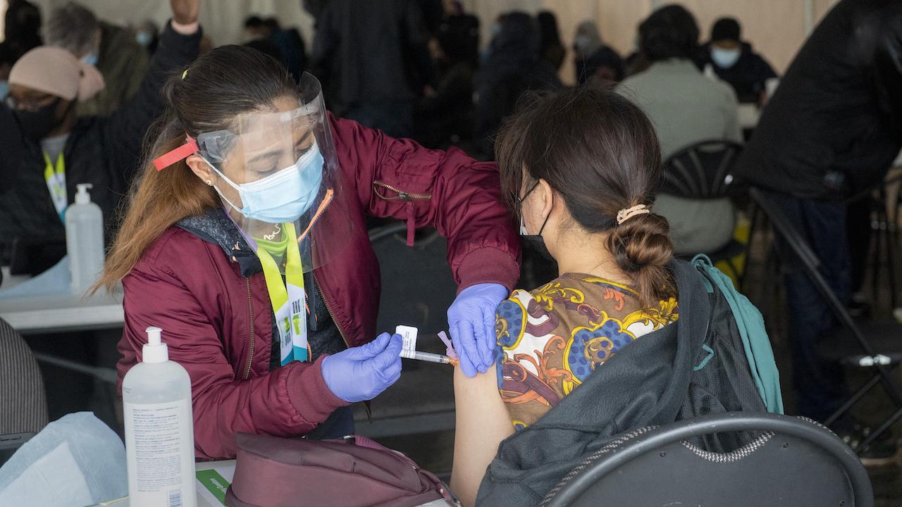 A nurse administers a COVID-19 vaccine in Toronto