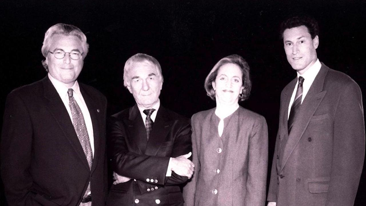 Four people standing together