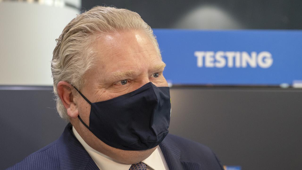 headshot of a man wearing a blue mask