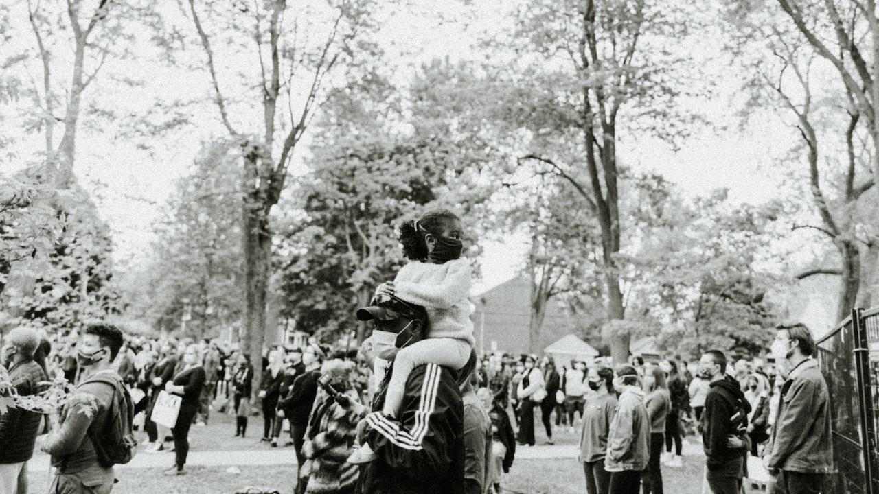 protestor with child on his shoulders