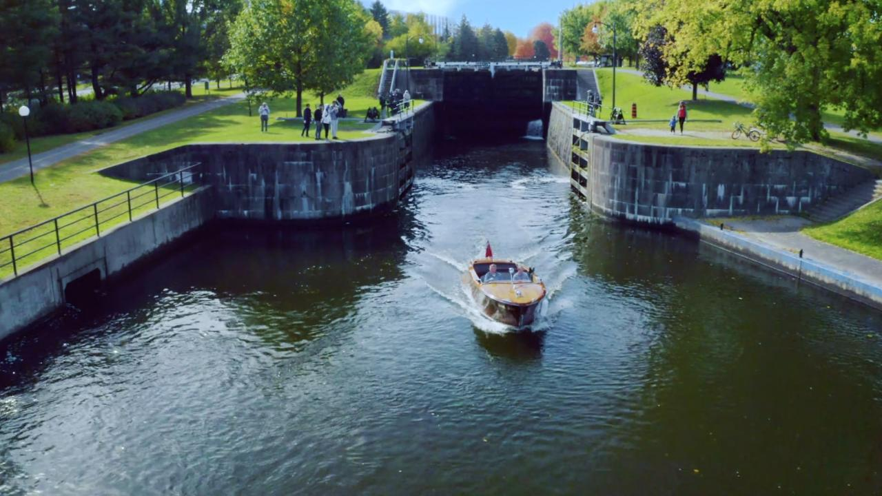 Boat going through a canal.