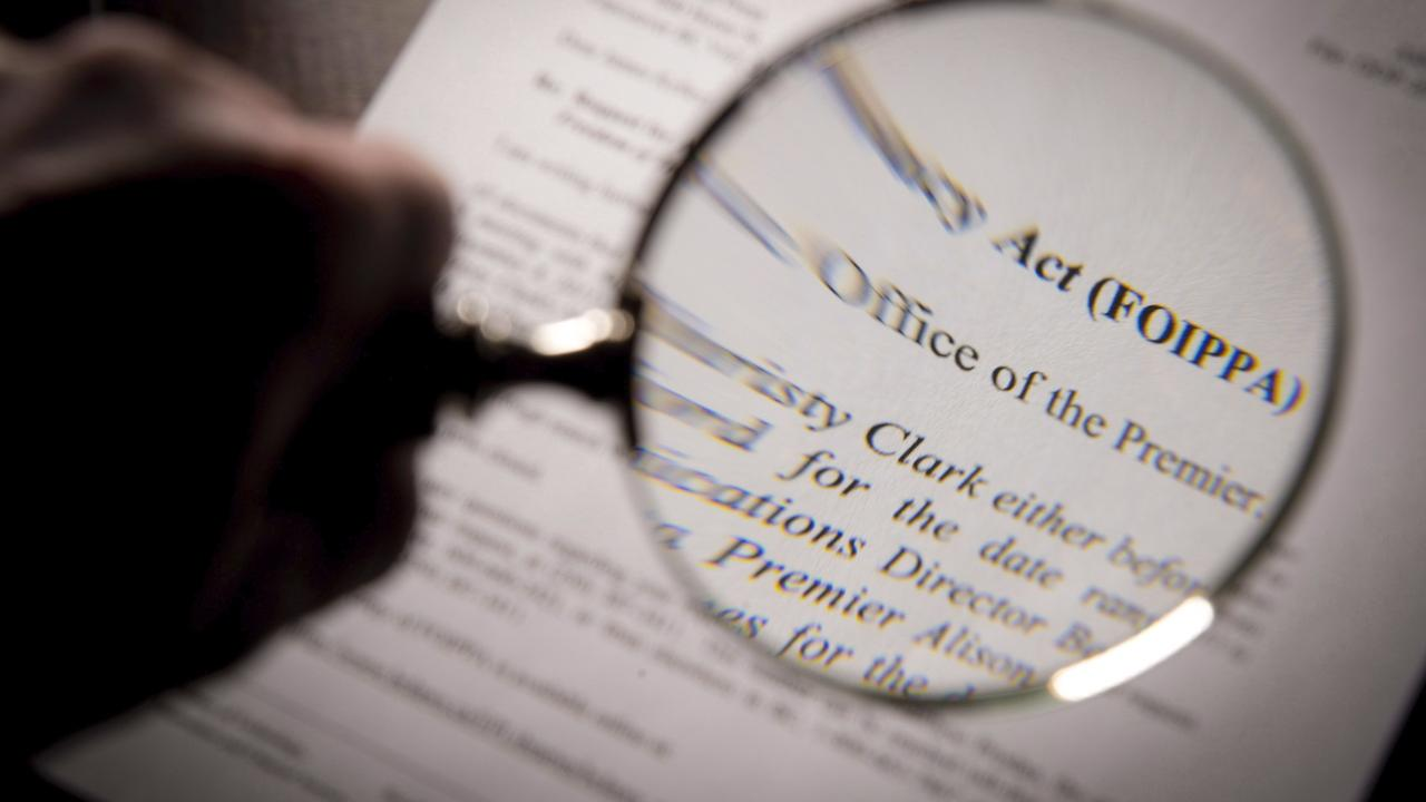 a magnifying glass held over an FOI form