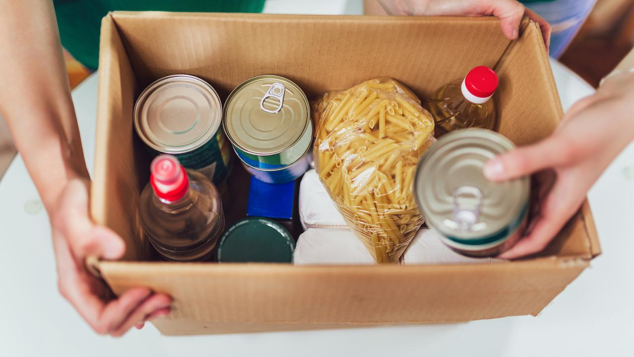 a box filled with canned food