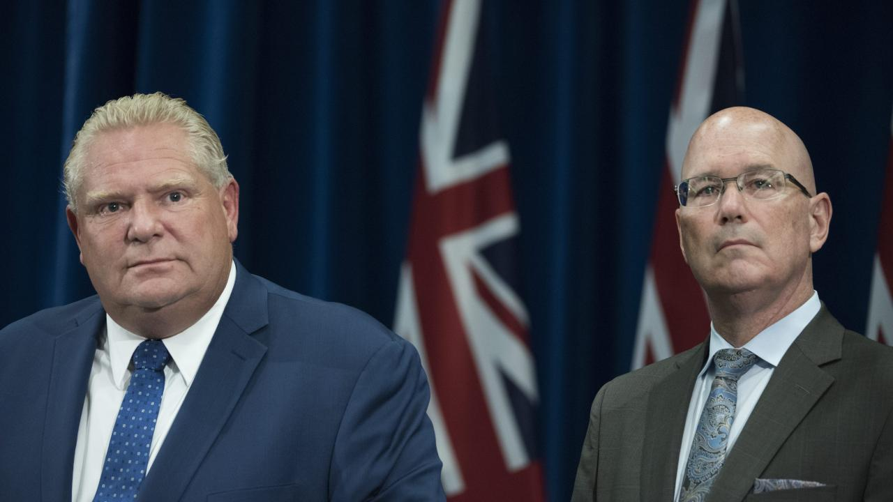 Premier Doug Ford (left) and Steve Clark, minister of municipal affairs and housing