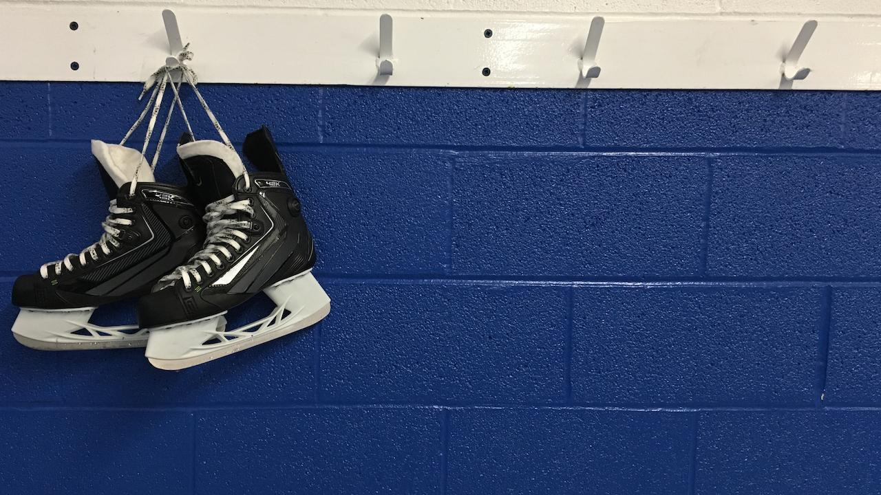 a pair of skates hanging on a hook