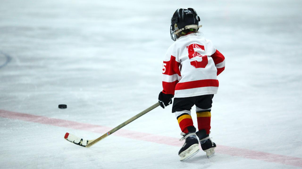 young hockey player from the back
