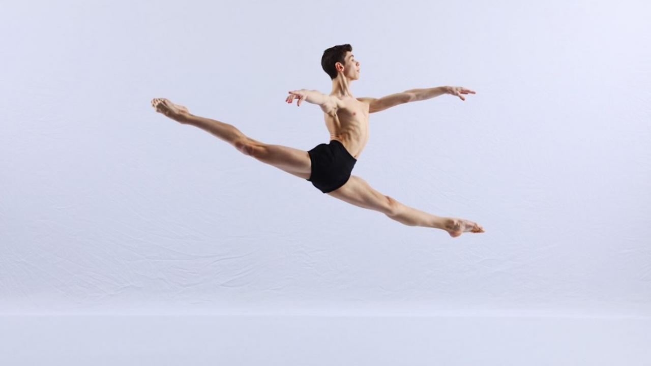 Young man leaps into the air.
