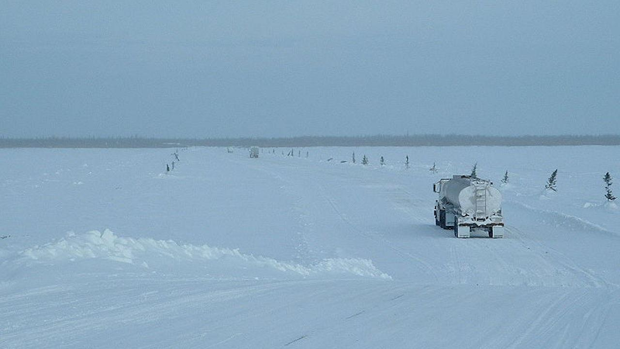 a truck drives along an ice road