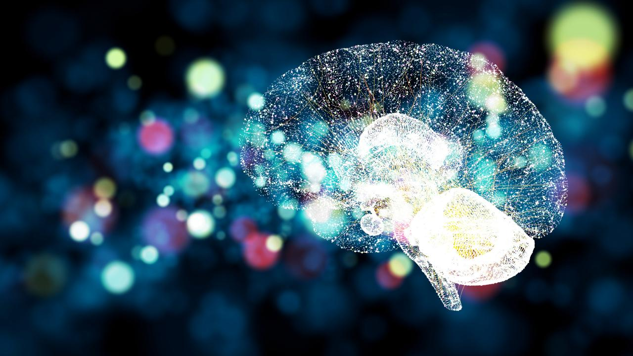 Illustration of a brain lit up as if it was made of of tiny lights.