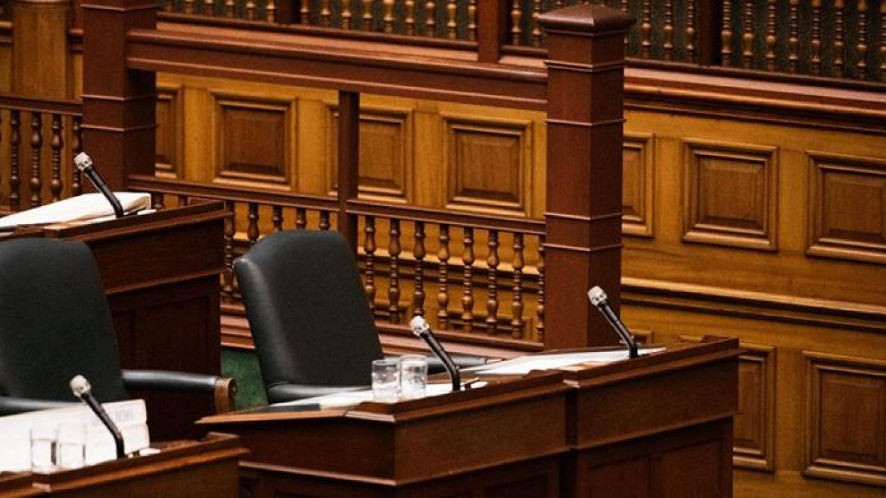 empty desk in the Ontario legislature