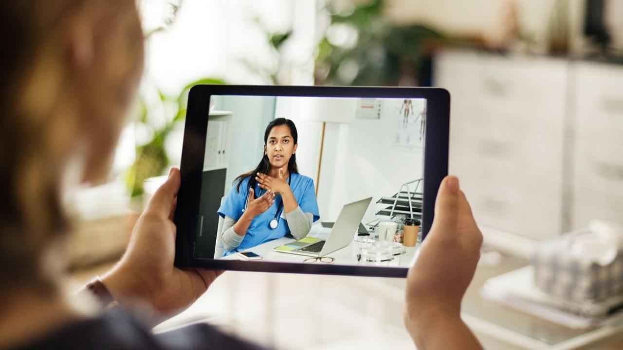 woman on a virtual call on tablet