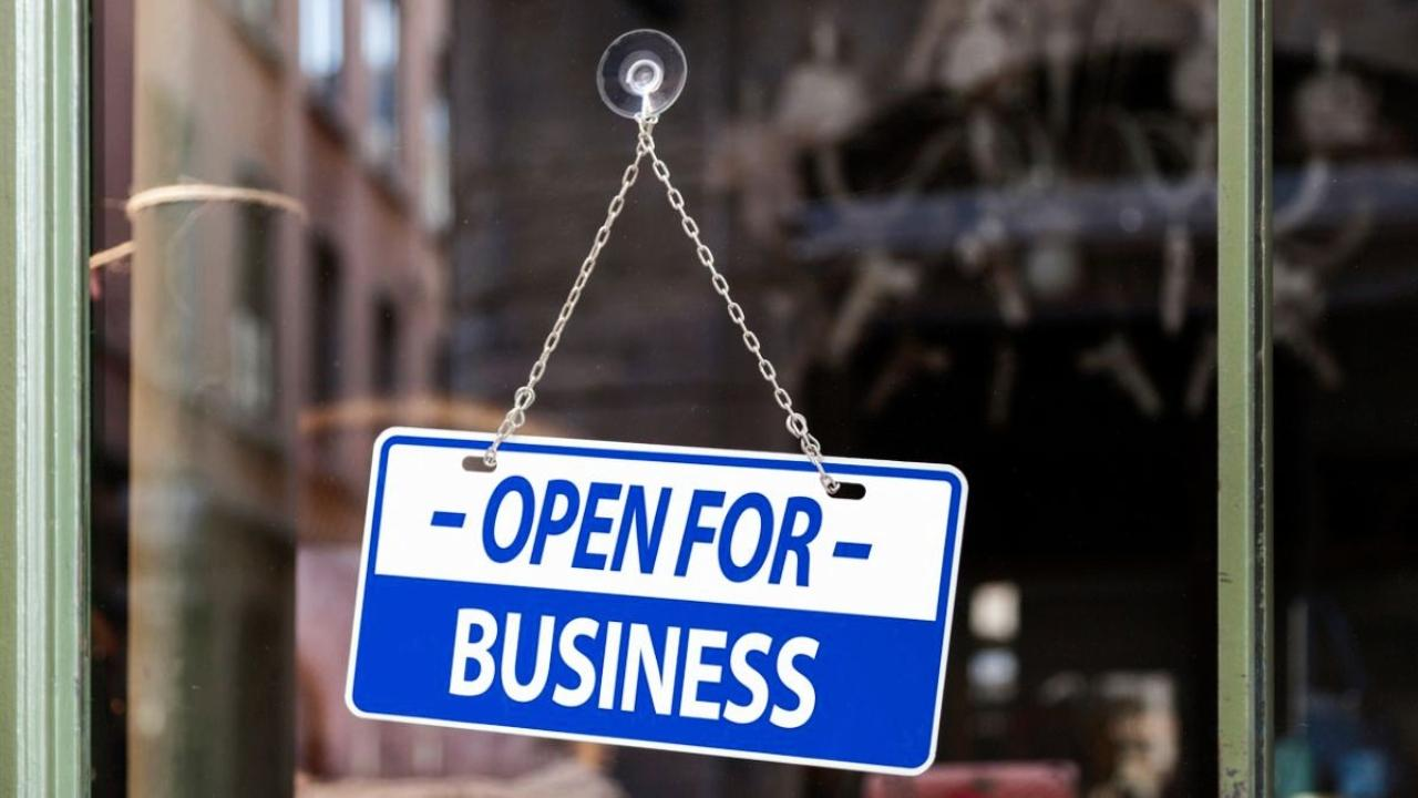 storefront sign saying Open for Business