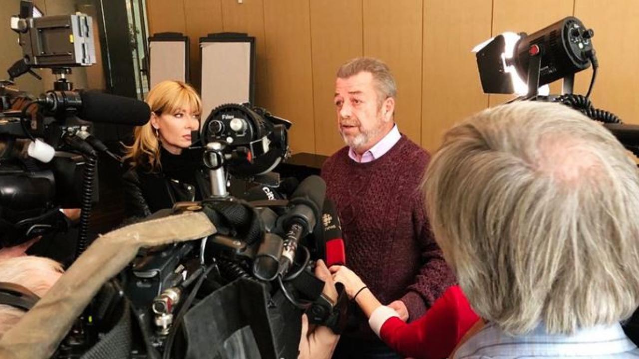 a man talking to media