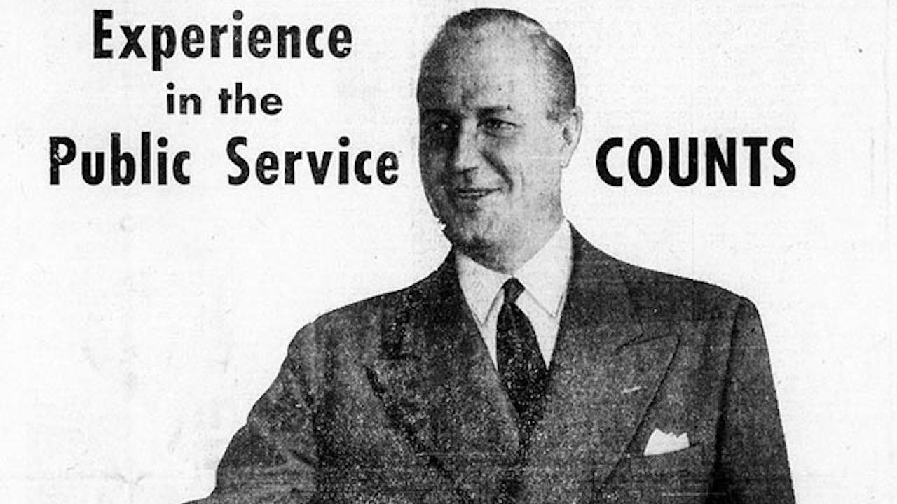 """black and white photo of a smiling man in a suit, with the words """"experience in the public sector counts"""""""