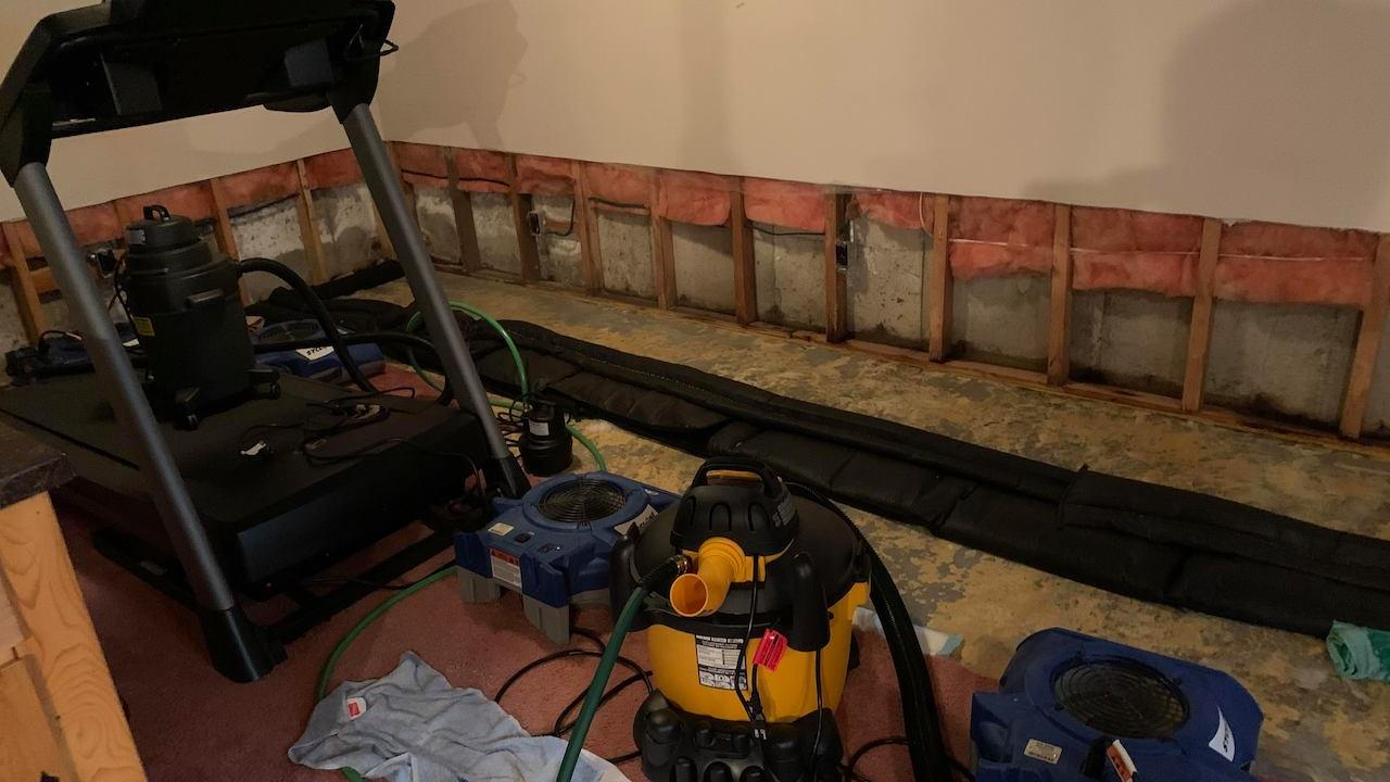 a basement room filled with machines and plumbing equipment