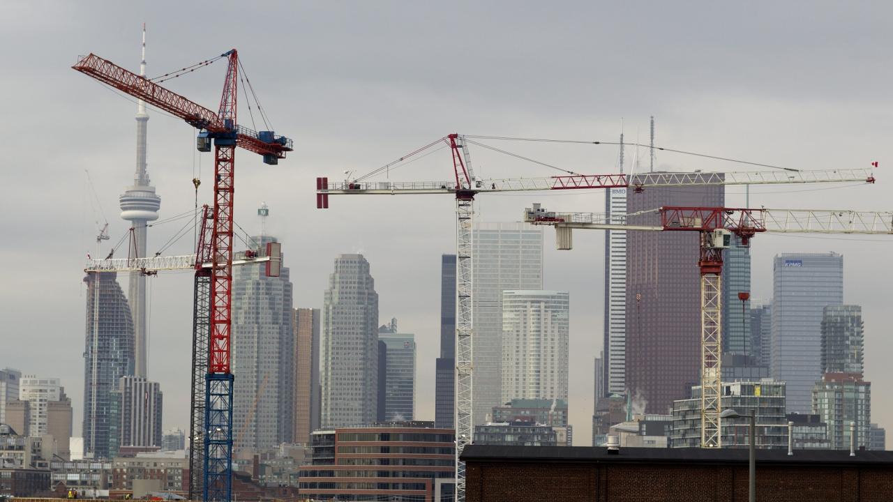 Toronto skyline with construction cranes