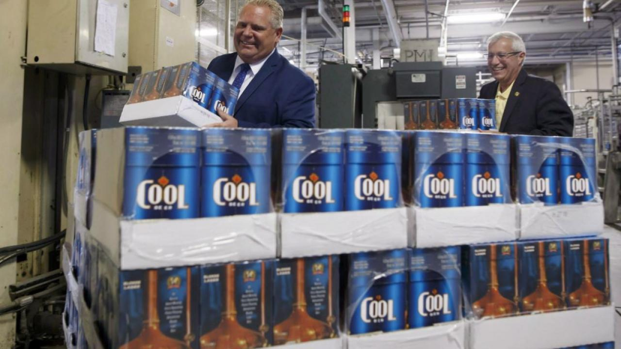 Premier Doug Ford and Minister of Finance Vic Fedeli carrying beer in an Ontairo beer store