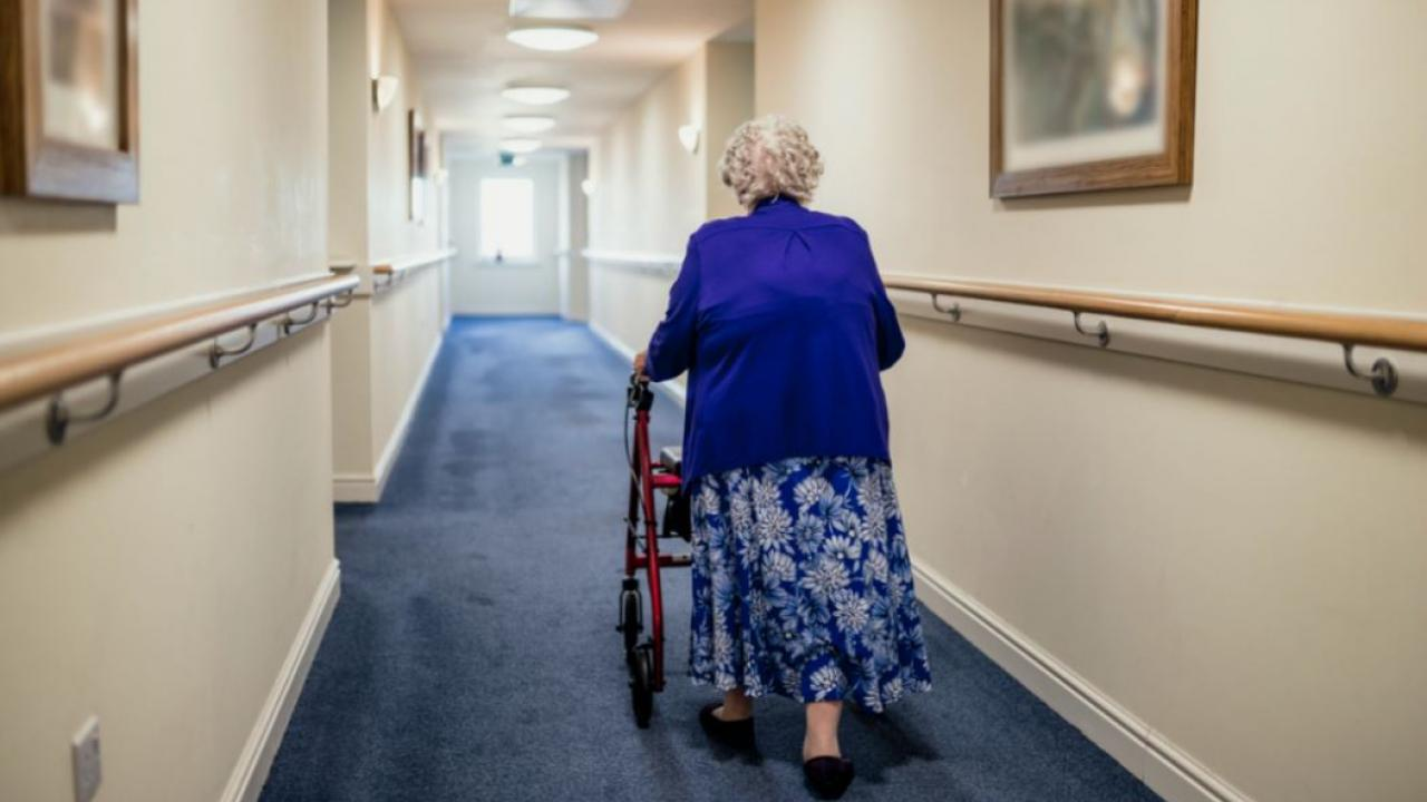 an elderly woman with a walker in a care home