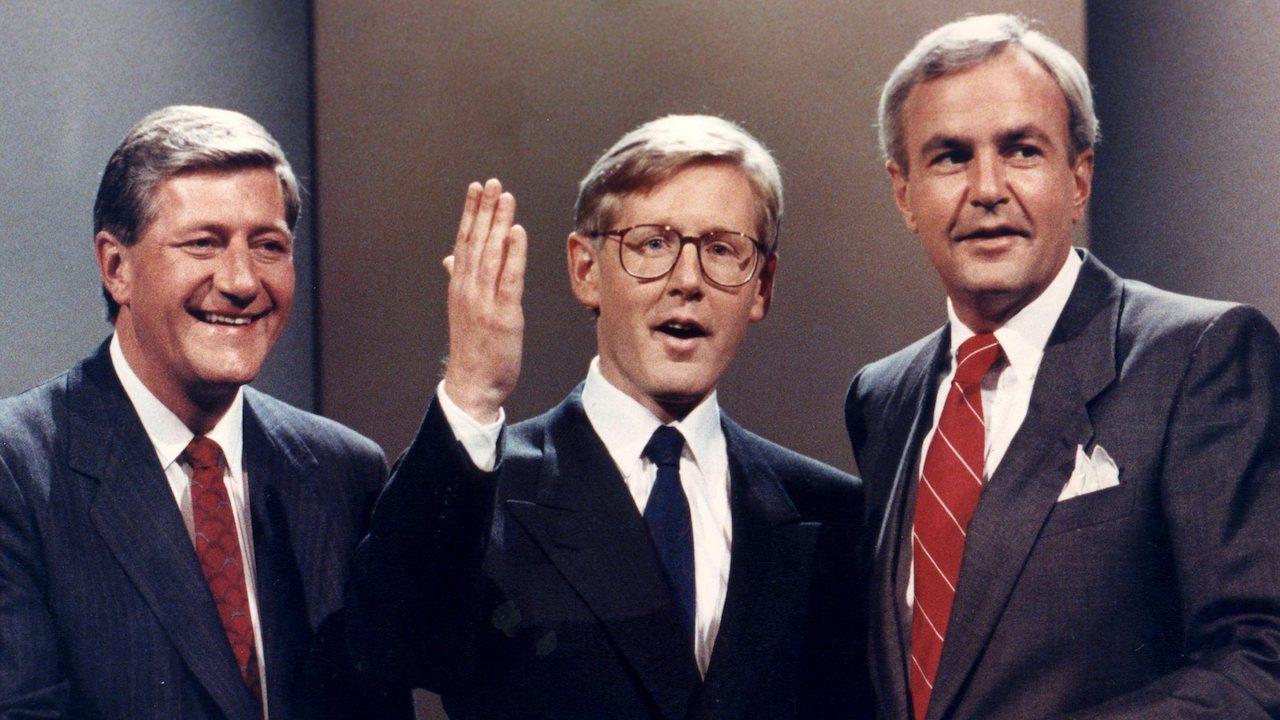 closeup of three men in suits