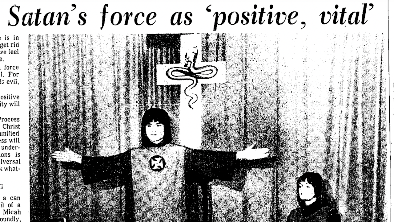 """newspaper clipping titled """"Satan's force as 'positive, vital"""" with photo of man in robe with hands raised in front of a cross"""