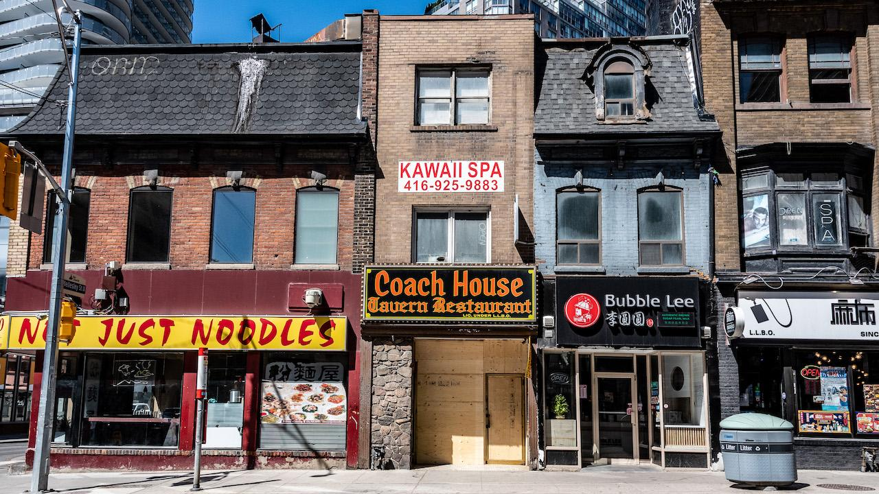 a row of closed storefronts